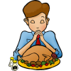 Boy praying before Thanksgiving meal