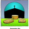 Communion Bread and Cup. In the background through a window is a cross