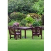 This is a photograph of a wood table and chairs next to a beautiful garden. Great for church bulletin in summer!